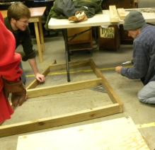 Volunteers building chicken coops for Caroline residents