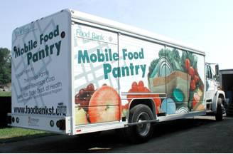 A mobile food pantry truck making Caroline Food Pantry distributions