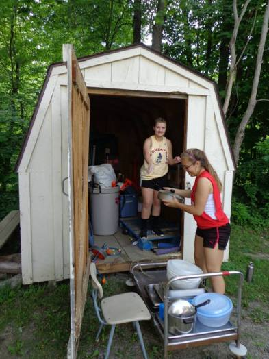 BCC Volunteers organizing a shed