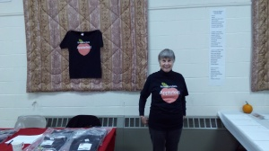 BCC board co-Chair Carol Barra wearing an Apple Fest T-shirt